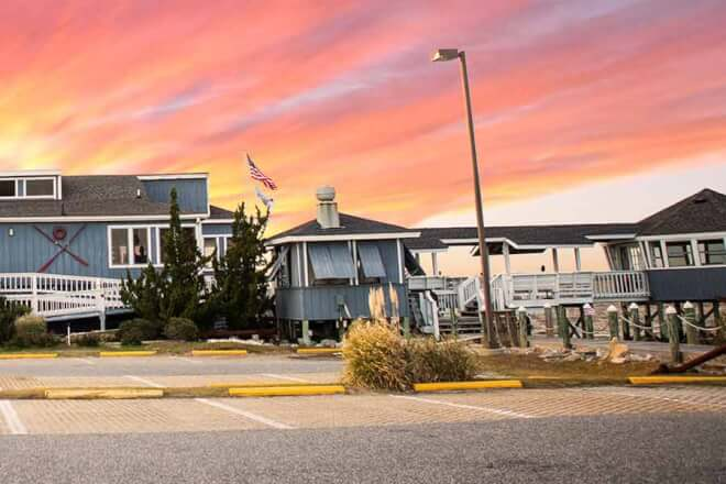 Sugar Creek Seafood Restaurant building at sunset